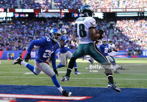 Jeremy Maclin of the Philadelphia Eagles catches a touchdown during their game against Prince Amukamara of the New York Giants at MetLife Stadium on...