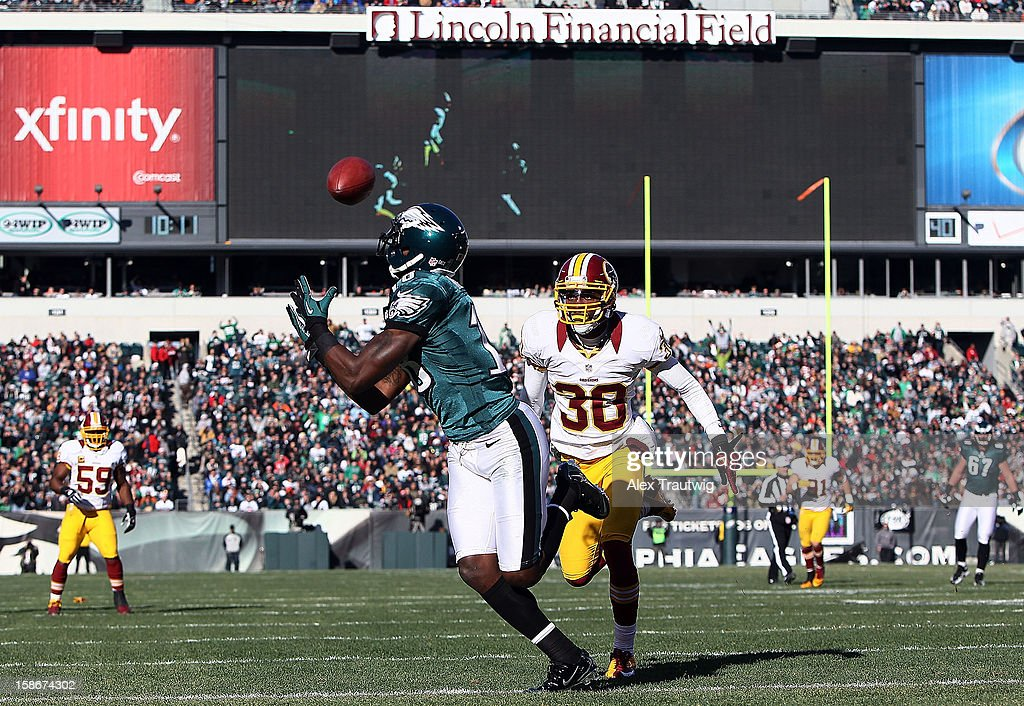 Jeremy Maclin #18 of the Philadelphia Eagles catches a touchdown in the first quarter as DJ Johnson #30 of the Washington Redskins defends at Lincoln Financial Field on December 23, 2012 in Philadelphia, Pennsylvania.