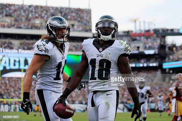 Jeremy Maclin of the Philadelphia Eagles celebrates his fourth quarter touchdown with teammate Riley Cooper during the game against the Washington...