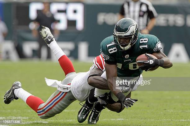 Jeremy Maclin of the Philadelphia Eagles is tackled by a New York Giants defender during the game at Lincoln Financial Field on September 25 2011 in...