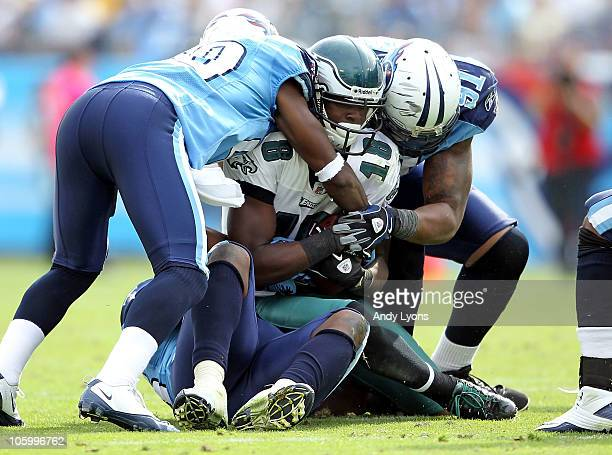 Jeremy Maclin of the Philadelphia Eagles is tackled by the Tennessee Titans defense at LP Field on October 24 2010 in Nashville Tennessee
