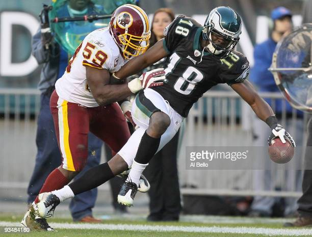 Jeremy Maclin of the Philadelphia Eagles makes a catch and is pushed out of bounds by London Fletcher of the Washington Redskins during their game at...