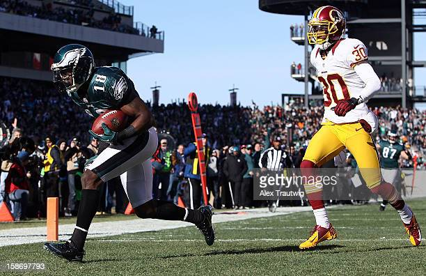 Jeremy Maclin of the Philadelphia Eagles runs in for a touchdown in the first quarter as DJ Johnson of the Washington Redskins defends at Lincoln...