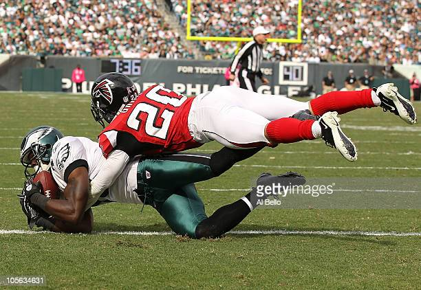 Jeremy Maclin of the Philadelphia Eagles scores a touchdown against Brent Grimes of the Atlanta Falcons during their game at Lincoln Financial Field...