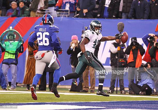 Jeremy Maclin of the Philadelphia Eagles scores a touchdown against Antrel Rolle of the New York Giants during their game on December 19 2010 at The...