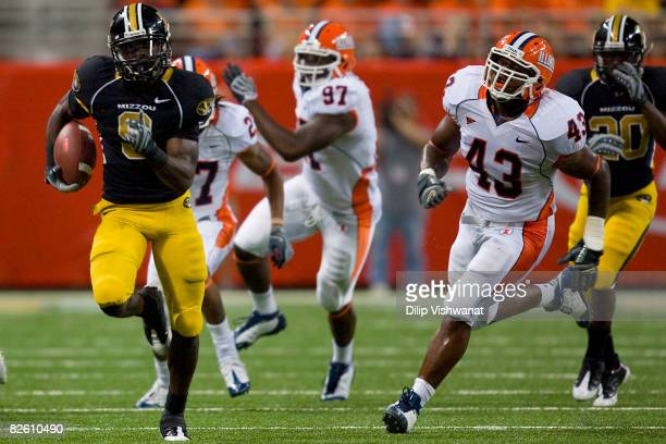 Jeremy Maclin of the University of Missouri Tigers rushes against Sam Carson III of the University of Illinois Fighting Illini during the State Farm...