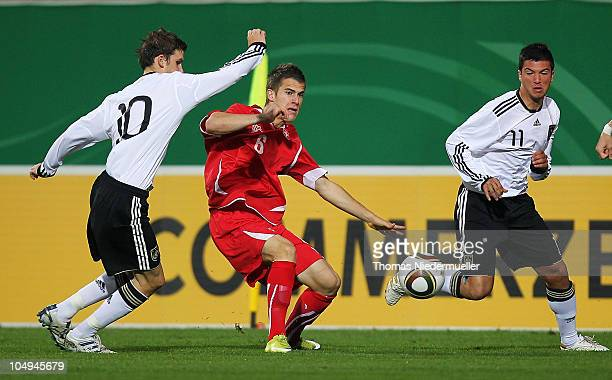 Jeremy Maniere of the Switzerland fights for the ball with Pascal Gross and Marco Terrazzino of Germany during the men's U20 International friendly...
