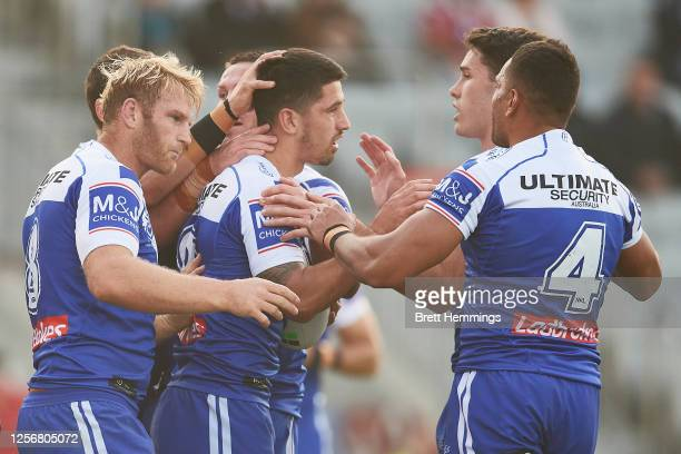 Jeremy Marshall-King of the Bulldogs celebrates scoring a try with team mates during the round 10 NRL match between the St George Illawarra Dragons...