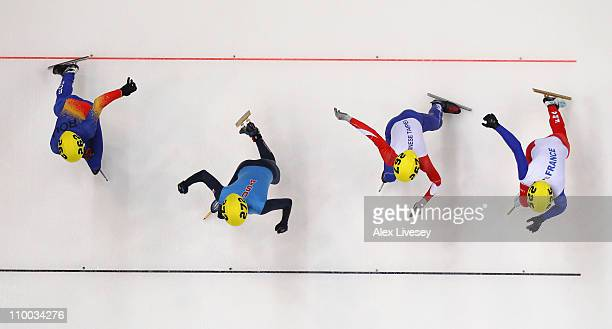 Jeremy Masson of France YangChun Wang of Taipei Simon Cho of USA and Istvan GalOravecz start in the Mens 500m Preliminaries during day two of the ISU...