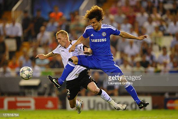 Jeremy Matheiu of Valencia is tackled by David Luiz of Chelsea during the UEFA Champions League Group E match between Valencia CF and Chelsea at the...