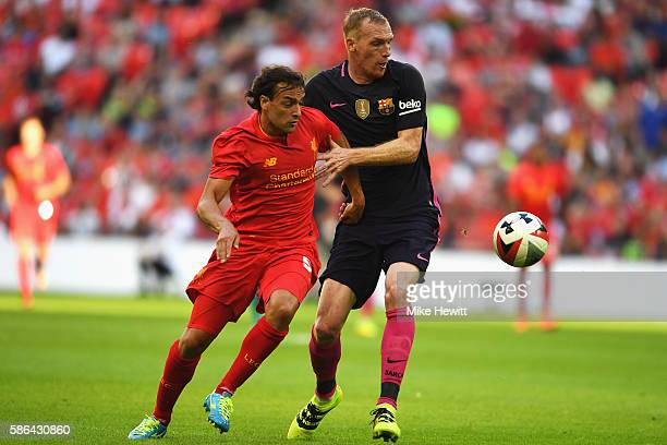 Jeremy Mathieu of Barcelona and Lazar Markovic of Liverpool in action during the International Champions Cup match between Liverpool and Barcelona at...