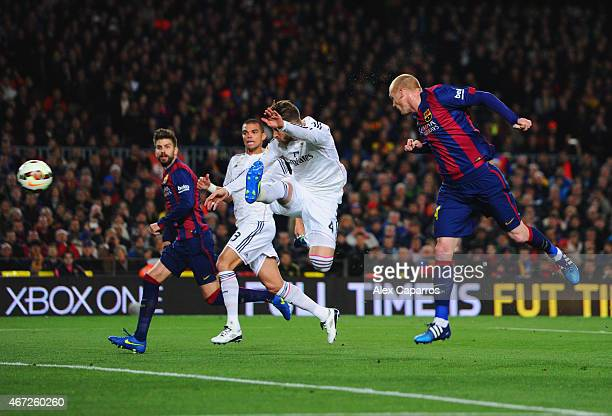 Jeremy Mathieu of Barcelona scores their first goal with a header during the La Liga match between FC Barcelona and Real Madrid CF at Camp Nou on...