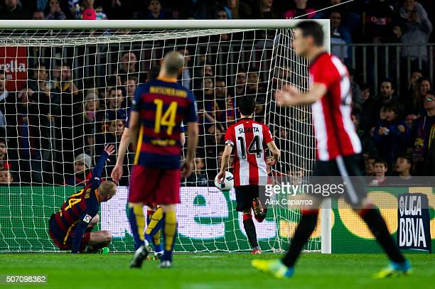 Jeremy Mathieu of FC Barcelona and Markel Susaeta of Athletic Club look as Inaki Williams scores the opening goal during the Copa del Rey Quarter...
