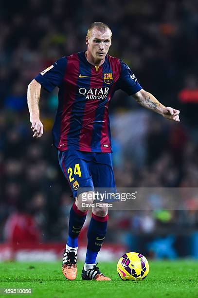 Jeremy Mathieu of FC Barcelona runs with the ball during the La Liga mach between FC Barcelona and Sevilla FC at Camp Nou on November 22 2014 in...