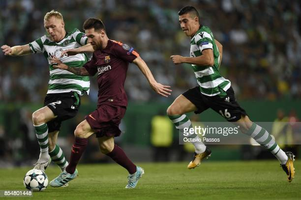 Jeremy Mathieu of Sporting CP competes for the ball with Lionel Messi of FC Barcelona during the UEFA Champions League group D match between Sporting...