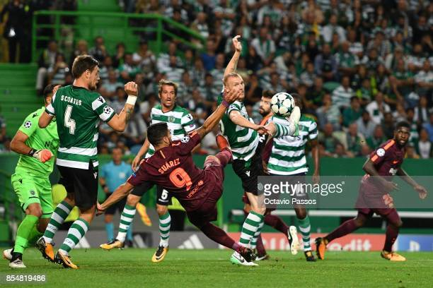 Jeremy Mathieu of Sporting CP competes for the ball with Luis Suarez of FC Barcelona during the UEFA Champions League group D match between Sporting...