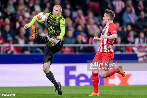 Jeremy Mathieu of Sporting CP fights for the ball with Kevin Gameiro of Atletico de Madrid during the UEFA Europa League quarter final leg one match...