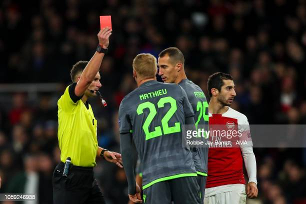 Jeremy Mathieu of Sporting CP receives a straight red card during the UEFA Europa League Group E match between Arsenal and Sporting CP at Emirates...
