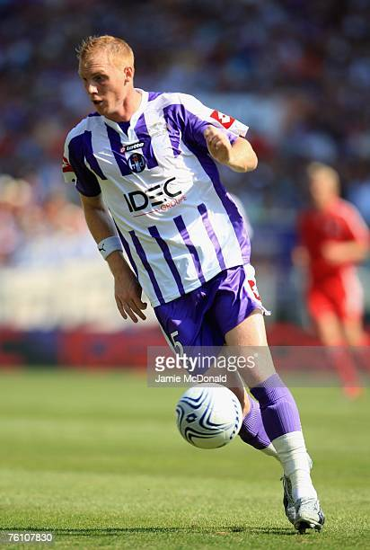 Jeremy Mathieu of Toulouse in action during the Champions League first leg of the third qualifying round match between Toulouse and Liverpool at the...