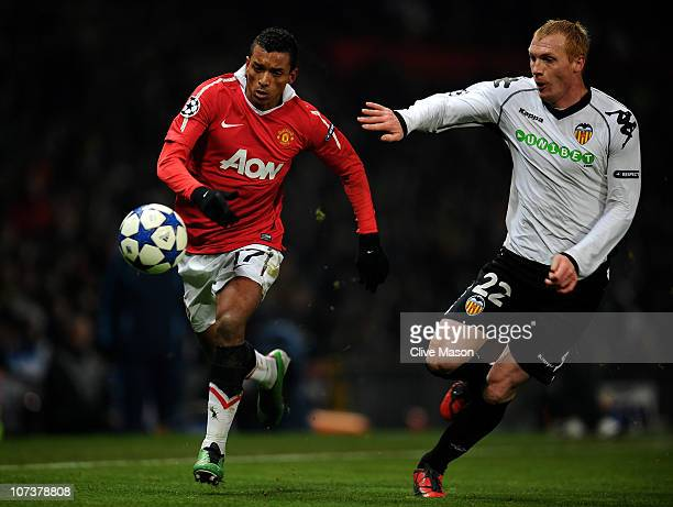 Jeremy Mathieu of Valencia chases Nani of Manchester United during the UEFA Champions League Group C match between Manchester United and Valencia at...