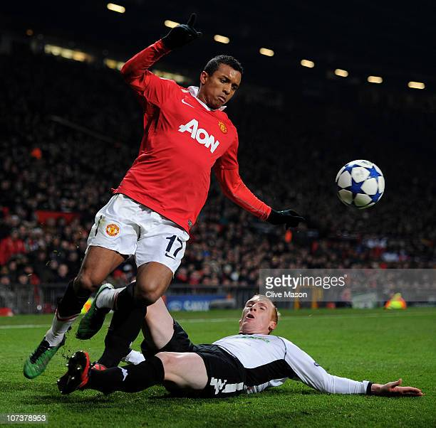 Jeremy Mathieu of Valencia tackles Nani of Manchester United during the UEFA Champions League Group C match between Manchester United and Valencia at...