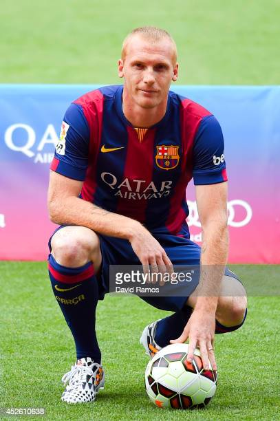 Jeremy Mathieu poses as a new player of FC barcelona at the Camp Nou on July 24 2014 in Barcelona Spain
