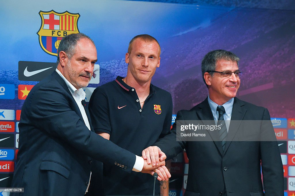 Jeremy Mathieu (C) poses with the FC Barcelona sport director Andoni Zubizarreta (L) and FC Barcelona Vice-President Jordi Mestre as a new player of FC Barcelona at the Camp Nou on July 24, 2014 in Barcelona, Spain.
