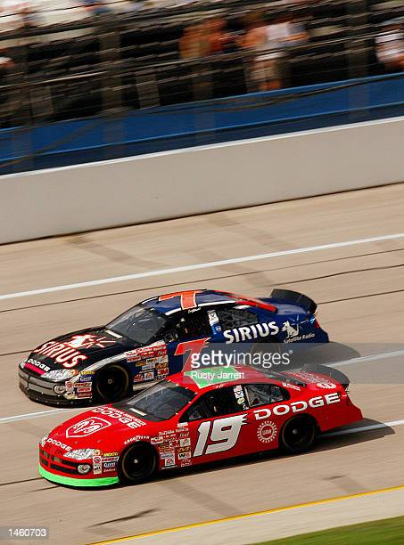 Jeremy Mayfield driver of the Evernham Motorsports Dodge Intrepid R/T and Casey Atwood driver of the Ultra Motorsports Dodge Intrepid R/T race...