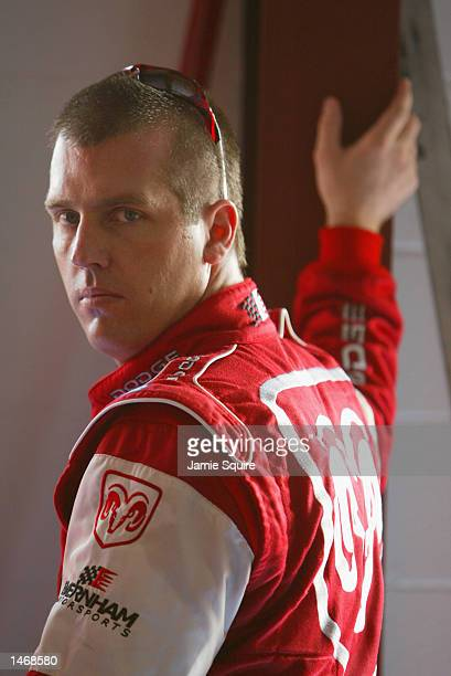 Jeremy Mayfield driver of the Evernham Motorsports Dodge Intrepid R/T waits in the garage during practice for the EA Sports 500 at Talladega...