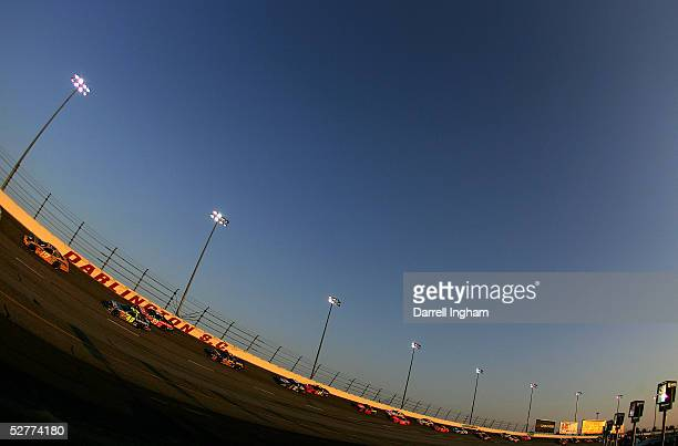 Jeremy Mayfield driver of the Evernham Motorsports Dodge leads Jimmie Johnson in the Hendrick Motorsports Chevrolet and the pack during the NASCAR...