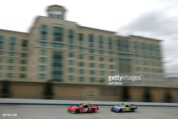 Jeremy Mayfield drives the Evernham Motorsports Dodge in front of Jimmie Johnson during practice for the NASCAR Nextel Cup Series MBNA NASCAR...