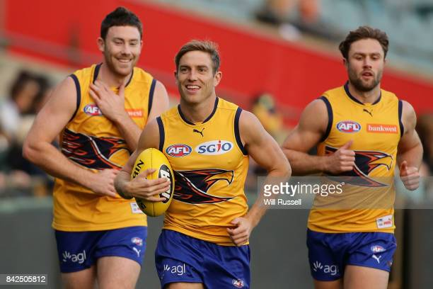 Jeremy McGovern Brad Sheppard and Mark Hutchings run laps during a West Coast Eagles AFL training session at Domain Stadium on September 4 2017 in...