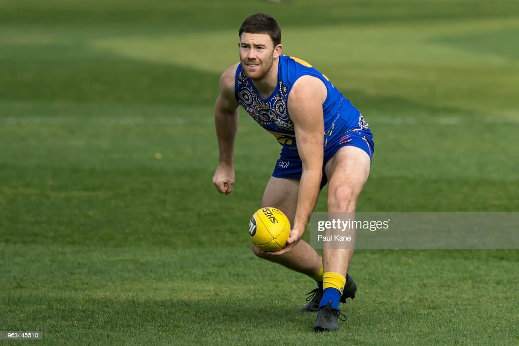 Jeremy McGovern handballs during a West Coast Eagles AFL training session at Subiaco Oval on May 29, 2018 in Perth, Australia.