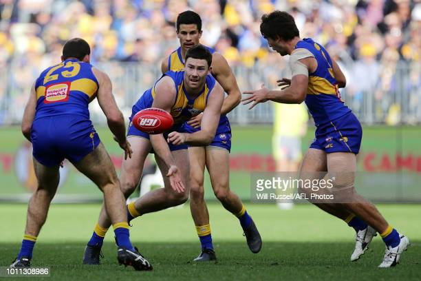 Jeremy McGovern handpasses the ball during the round 20 AFL match between the West Coast Eagles and the Fremantle Dockers at Optus Stadium on August...