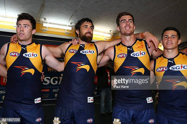 Jeremy McGovern Josh Kennedy Scott Lycett and Liam Duggan of the Eagles sing the club song after winning during the round eight AFL match between the...