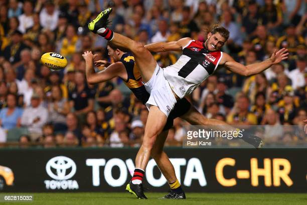 Jeremy McGovern of the Eagles and Josh Bruce of the Saints contest a mark during the round two AFL match between the West Coast Eagles and the St...