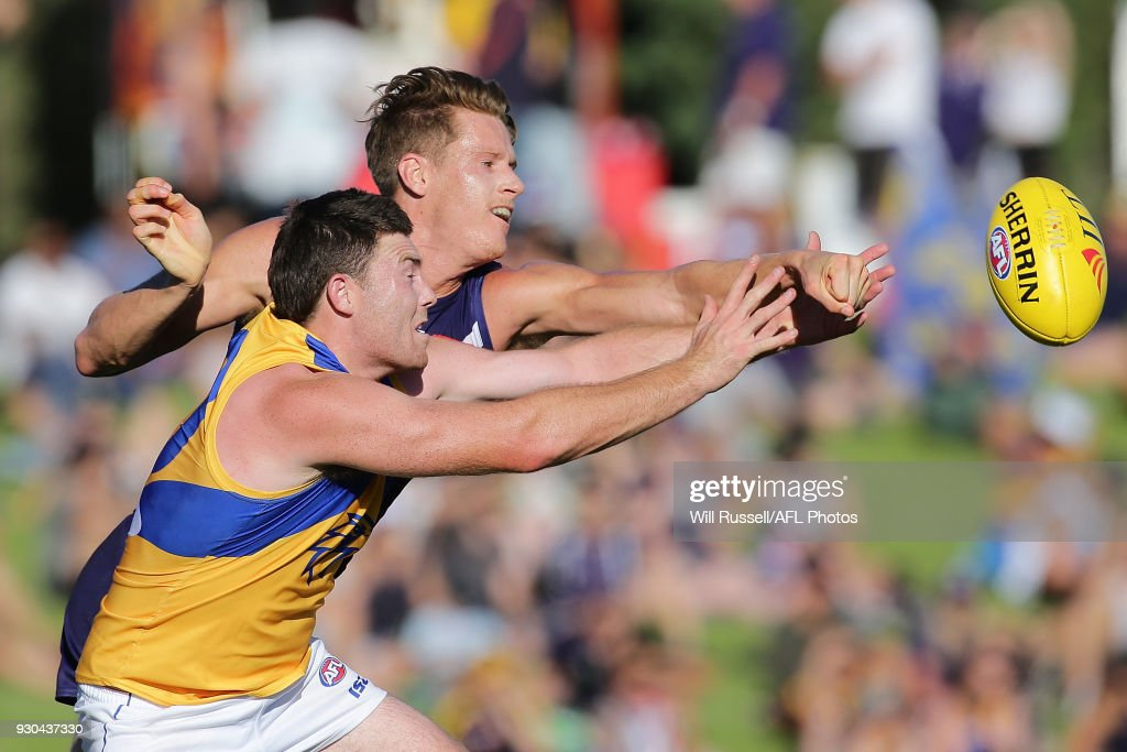 Jeremy McGovern of the Eagles and Matt Taberner of the Dockers in action during the JLT Community Series AFL match between the Fremantle Dockers and the West Coast Eagles at HBF Arena on March 11, 2018 in Perth, Australia.