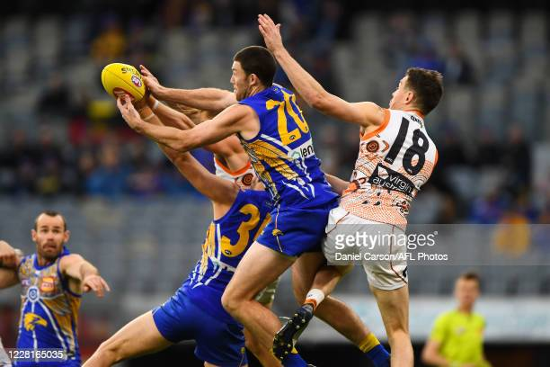 Jeremy McGovern of the Eagles attempts a mark during the 2020 AFL Round 13 match between the West Coast Eagles and the GWS Giants at Optus Stadium on...