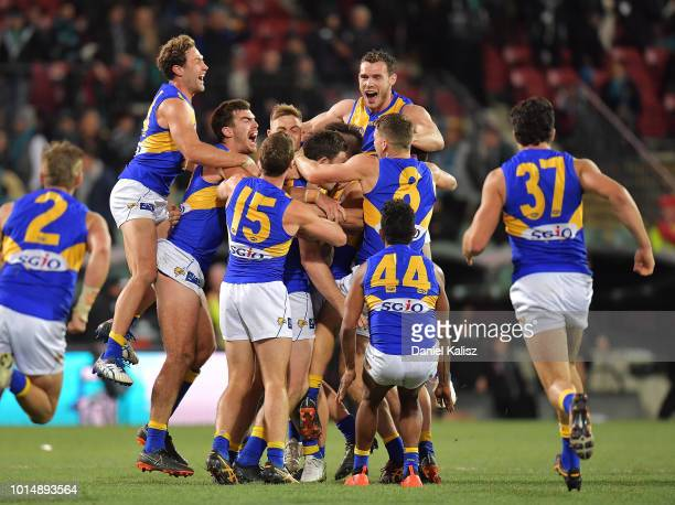 Jeremy McGovern of the Eagles celebrates with his team mates after kicking a goal after the siren to win during the round 21 AFL match between the...