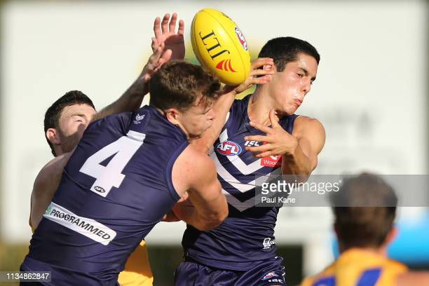 Jeremy McGovern of the Eagles contests a mark against Sean Darcy and Adam Cerra of the Dockers during the 2019 JLT Community Series AFL match between...