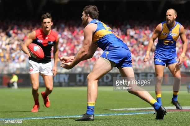 Jeremy McGovern of the Eagles handballs during the AFL Prelimary Final match between the West Coast Eagles and the Melbourne Demons on September 22...