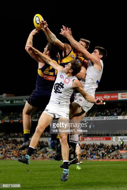 Jeremy McGovern of the Eagles juggles the mark during the round 21 AFL match between the West Coast Eagles and the Carlton Blues at Domain Stadium on...