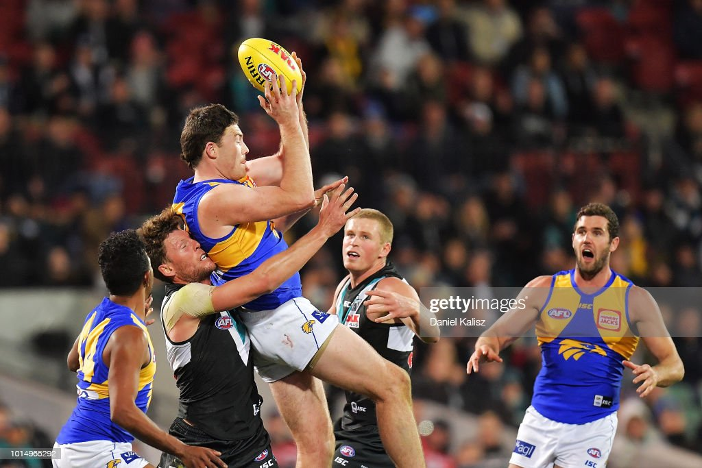 Jeremy McGovern of the Eagles marks the ball before the siren during the round 21 AFL match between the Port Adelaide Power and the West Coast Eagles at Adelaide Oval on August 11, 2018 in Adelaide, Australia.