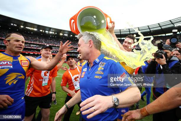 Jeremy McGovern of the Eagles pours Gatorade on Adam Simpson Senior Coach of the Eagles after winning the 2018 Toyota AFL Grand Final match between...