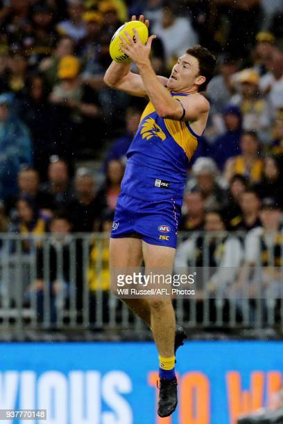 Jeremy McGovern of the Eagles takes an overhead mark during the round one AFL match between the West Coast Eagles and the Sydney Swans at Optus...