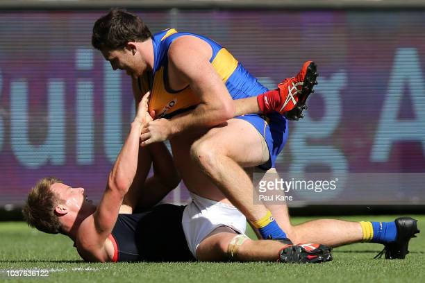 Jeremy McGovern of the Eagles wrestles with Mitch Hannan of the Demonsduring the AFL Preliminary Final match between the West Coast Eagles and the...