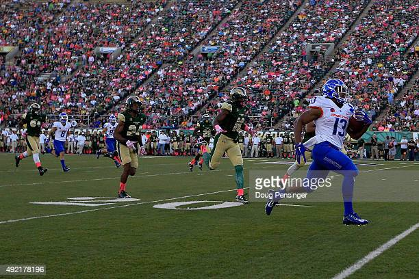 Jeremy McNichols of the Boise State Broncos eludes the Colorado State Rams defense as he runs 56 yards for a touchdown to take a 170 lead in the...