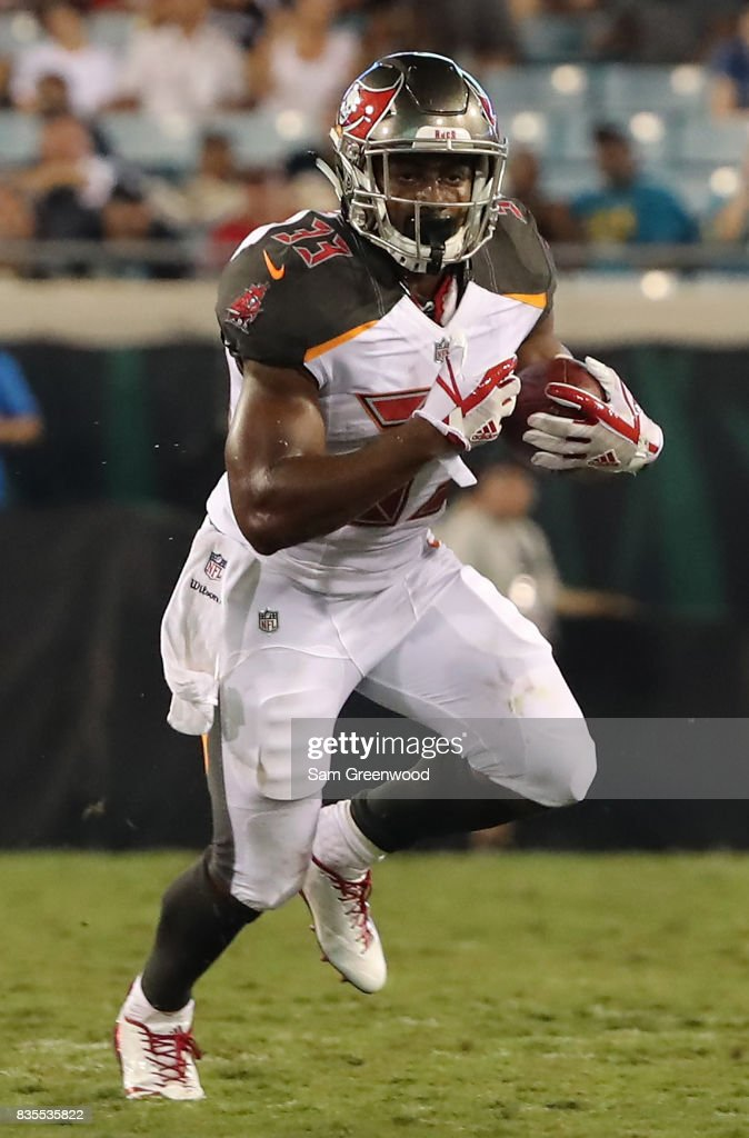 Jeremy McNichols #33 of the Tampa Bay Buccaneers runs for yardage during a preseason game against the Jacksonville Jaguars at EverBank Field on August 17, 2017 in Jacksonville, Florida.