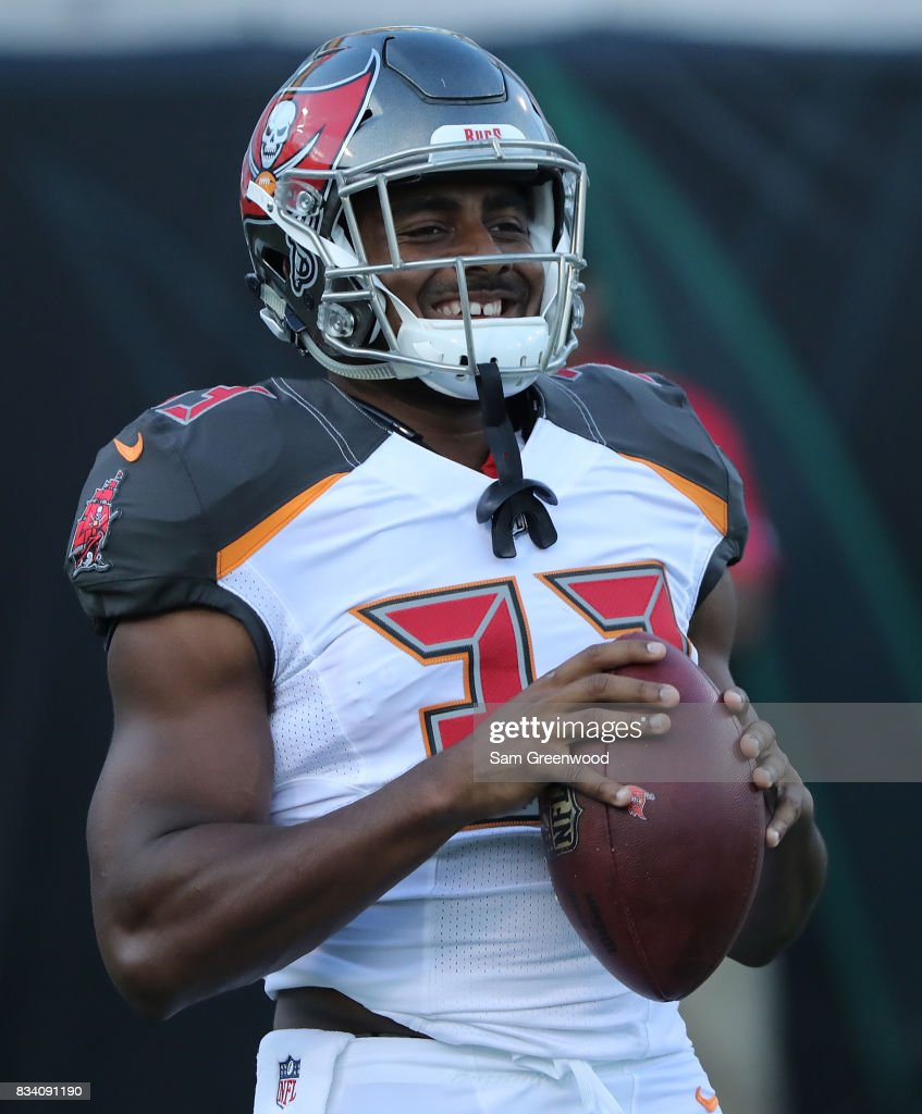 Jeremy McNichols #33 of the Tampa Bay Buccaneers warms during a preseason game against the Jacksonville Jaguars at EverBank Field on August 17, 2017 in Jacksonville, Florida.