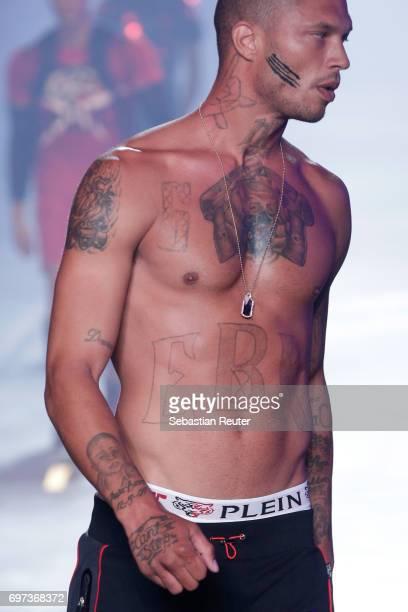 Jeremy Meeks walks the runway at the Plein Sport show during Milan Men's Fashion Week Spring/Summer 2018 on June 18 2017 in Milan Italy